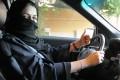 A woman behind the wheel in Riyadh – Saudi Arabia's ban on female drivers will be lifted next year. Photo: EPA