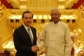 Myanmnese President U Htin Kyaw (right) greets Chinese Foreign Minister Wang Yi in Naypyidaw on Sunday. Photo: Xinhua