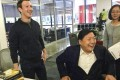 Facebook founder Mark Zuckerberg (left) hosts cyberspace administration minister Lu Wei at Facebook's headquarters. Photo: China Network