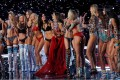 Models cheer each other at the Victoria's Secret Fashion Show in Shanghai on November 20. Photo: AP
