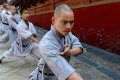 Monks practice Kongfu at Shaolin Temple in Dengfeng, central China's Henan Province. Photo: Xinhua