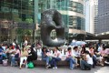 Domestic Helpers from the Philippines enjoy time off at Exchange Square in Central. Photo: Alamy