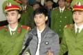 Nguyen Van Hoa (centre) was sentenced to seven years in prison. Photo: AP