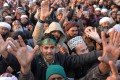 Islamists at a sit-in at a blocked flyover in Islamabad. Photo: AFP