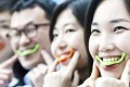 The so-called smile trainer is a silicone mouthpiece designed to improve the balance of your face.