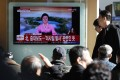 South Koreans watch a live TV report showing North Korea's missile test announcement at a station in Seoul on Wednesday. Photo: EPA