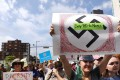 """Thousands of protesters march in Boston in August against a planned """"Free Speech Rally"""" one week after the violent """"Unite the Right"""" rally in Virginia left one woman dead and dozens more injured. Photo: AFP"""