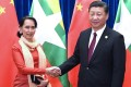 Aung San Suu Kyi meets Xi Jinping during an international conference in Beijing on Friday. Photo: Xinhua