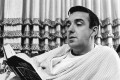 In this November 14, 1967 file photo, singer and actor Jim Nabors reads a book at his California home. Nabors died peacefully at his home in Honolulu on Thursday with his husband Stan Cadwallader at his side. Photo: AP