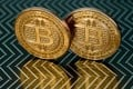 File photo of bitcoin in Washington. A senior Fed official warned bitcoin may pose a threat to financial stability after racing past US$11,000 this week. Photo: AFP