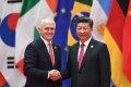 Australia's Prime Minister Malcolm Turnbull shakes hands with Chinese President Xi Jinping before the G20 leaders' family photo in Hangzhou, on September 4, 2016. Photo: AFP