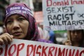 An Indonesian protesters at a rally against Donald Trump. Photo: AP