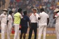 Umpire Nigel Llong, third from right, explained the decision to Sri Lanka players. Photo: AP