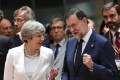 British Prime Minister Theresa May chats with Spanish Prime Minister Mariano Rajoy during a European Council meeting on June 23, in Brussels. Photo: AFP