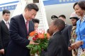 Chinese President Xi Jinping is greeted upon his arrival at Waterkloof Air Force Base in Pretoria, South Africa, in December 2015. Photo: EPA