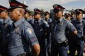 Police officers who underwent a retraining and reorientation programme as part of internal cleansing efforts of the Philippine National Police. Photo: EPA
