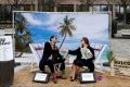 Activists stage a protest on a mock tropical island beach representing a tax haven outside a meeting of European Union finance ministers in Brussels, Belgium, on Tuesday. Photo: Reuters