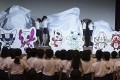 Pupils unveil the shortlisted three mascot design sets which each contain one mascot for the Tokyo 2020 Olympic Games and one for the Paralympic Games. Photo: AP