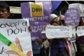 Demonstrators hold up posters and shout slogans during a rally in front of the Department of Health office in Manila, following the suspension of the sale and distribution of Sanofi's dengue vaccine Dengvaxia. Photo: AFP