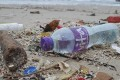 Plastic bottles, caps, and polystyrene lies among other debris, washed up onto Big Wave Bay beach in Shek O, Hong Kong. Photo: Antony Dickson