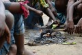 Members of the Musahar community roast a rat in Alampur Gonpura village, in the eastern Indian state of Bihar. Photo: AFP