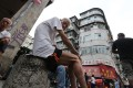 Elderly residents sit on a street in Sham Shui Po. Photo: Edward Wong