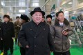 North Korean leader Kim Jong-un (C) inspecting the newly-built Samjiyon potato farina production factory in Ryanggang Province, North Korea. Photo: KCNA via AFP