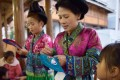 Women of the Miao ethnic group work on embroidery in southwest China's Guizhou province, on December 1. Increasing the economic opportunities for women seems a natural way to increase development opportunities around the world, if discrimination can be overcome. Photo: Xinhua