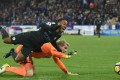 Manchester City's Raheem Sterling fails to get a penalty after a clash with Huddersfield goalkeeper Jonas Lossl. Photo: AFP