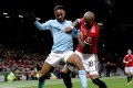 Manchester United's Ashley Young (R) challenges Manchester City's Raheem Sterling during the English Premier League soccer match at Old Trafford Stadium. Photo: EPA-EFE