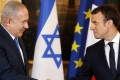 French President Emmanuel Macron (R) and Israeli Prime Minister Benjamin Netanyahu (L) hold a joint press conference at the Elysee Palace in Paris, France, on December 10, 2017. Macron said the decision by US President Donald Trump to recognise Jerusalem as Israel's capital is a 'danger to peace.' Photo: Pool via EPA-EFE