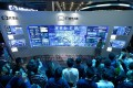 This October 11, 2017 photo shows visitors watching a visual logging system of city power data on the Computing Conference 2017 in Hangzhou. Photo: AFP