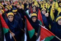 Lebanese women supporters of Hezbollah shout slogans against US President Donald Trump during a protest against Trump's decision to recognise Jerusalem as the capital of Israel, in the southern suburbs of Beirut on Monday. Photo: EPA