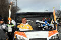 HUBO in the self-driving car with Professor Dennis Hong as a passenger during the torch relay in Daejeon. Photo: Yonhap