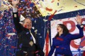 Democratic candidate for US Senate Doug Jones and his wife Louise wave to supporters after it was announced that he had defeated Republican Roy Moore. Photo: AP
