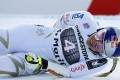 Lindsey Vonn grimaces in pain after crossing the finish line during the women's super-G race at the FIS Alpine Ski World Cup in St Moritz, Switzerland. Photo: EPA