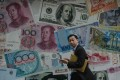 The Hong Kong dollar dropped against its US counterpart by the most in 22 months on Thursday. Photo: AFP