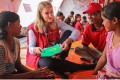 Helle Thorning-Schmidt, the former prime minister of Denmark and Save the Children International CEO, speaks to young refugees at a camp for Rohingya at Cox's Bazar in Bangladesh. Photo: Turjoy Chowdhury