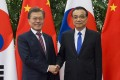 Both sides struck a positive note following Friday's meeting between Moon Jae-in, left, and Li Keqiang. Photo: EPA-EFA
