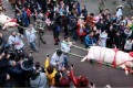 Two sacrifical pigs are paraded through the streets of Shangli Ancient Town in southwestern China's Sichuan province on Saturday at the start of an annual festival. Photo: CNA