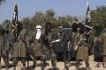 An image grab made on October 31, 2014, shows the leader of the Nigerian extremist group Boko Haram Abubakar Shekau (centre) delivering a speech. Photo: Agence France-Presse