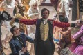 Hugh Jackman (centre) as P.T. Barnum in The Greatest Showman (category: IIA). The film, which co-stars Michelle Williams, Zac Efron, and Rebecca Ferguson, is directed by Michael Gracey.