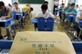 Candidates take the national college entrance exam in Hefei, capital of east China's Anhui Province. Photo: Xinhua
