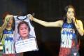 Mocha Uson, a blogger and supporter of Philippine President Rodrigo Duterte, displaying a T-shirt decorated with a photo of arrested legislator Senator Leila De Lima during a pro-Duterte rally. Photo: AFP