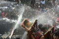 Riot policemen and protesters clash as they try to march to the Asean Summit venue in Manila. Photo: AFP