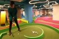 The start-up Strokes has opened Hong Kong's first mini-golf course inside a restaurant, in Fashion Walk, in Causeway Bay. Photo: Nora Tam
