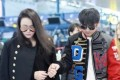 Chinese boxer Zou Shiming and wife Ran Yingying arrive in Shanghai to seek medical attention for a suspected detached retina. Photo: Sina.com.cn