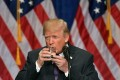 US President Donald Trump takes a drink of water as he speaks about his administration's National Security Strategy at the Ronald Reagan Building and International Trade Center in Washington, DC, December 18, 2017. Photo: Agence France-Presse