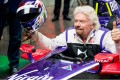 Richard Branson poses in the DS Virgin Racing car at the New York E-Prix. Photos: Handout