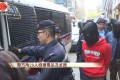 Hong Kong police arrested 29 people after a raid on a suspected triad bar on Christmas Day. Photo: Cable TV News